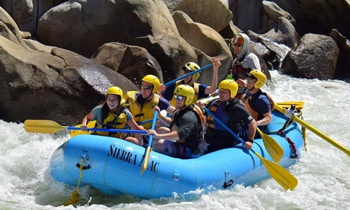 Paddle boat group rafting on the Tuolumne River