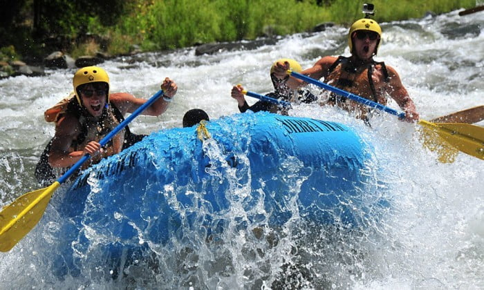 Whitewater paddlers explode through wave on Main Tuolumne River