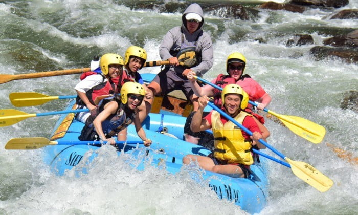 Family is guided through Tuolumne River rapid