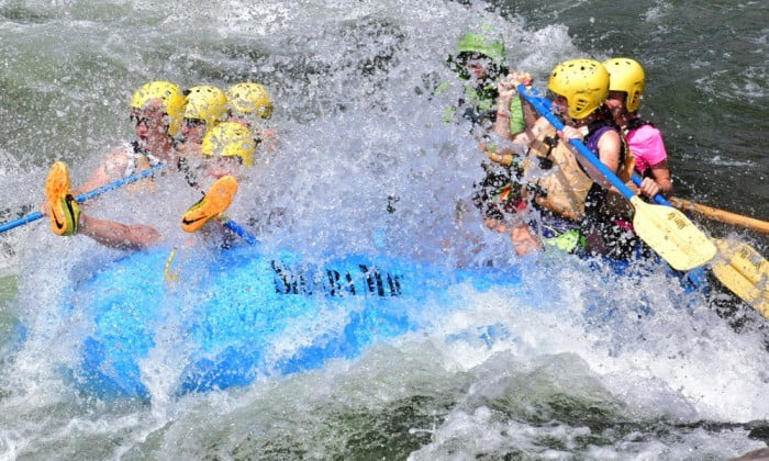 Paddle raft gets covered with water.
