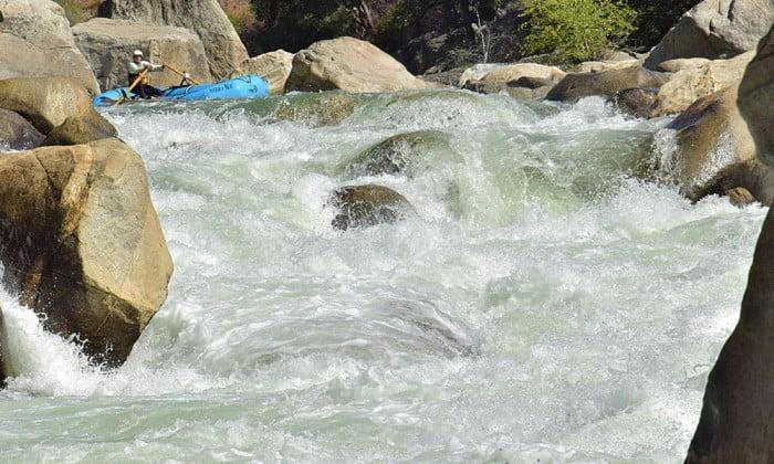 Oar boat negotiates rapid on Cherry Creek