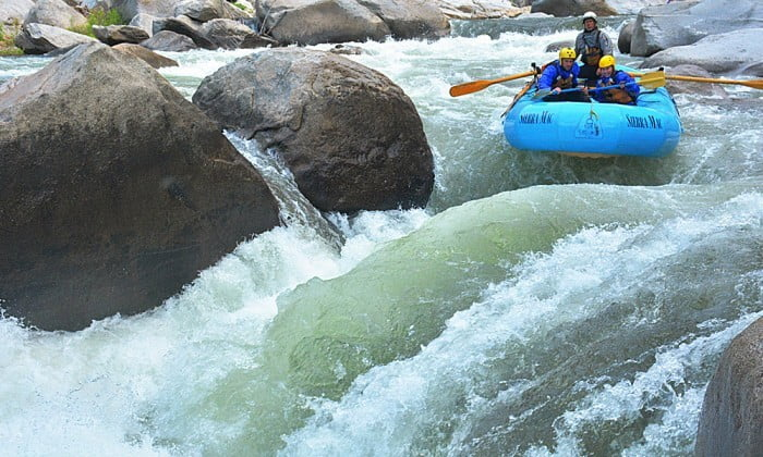Whitewater raft enjoys a perfect sidecurler at Slammer Wave on Cherry Creek