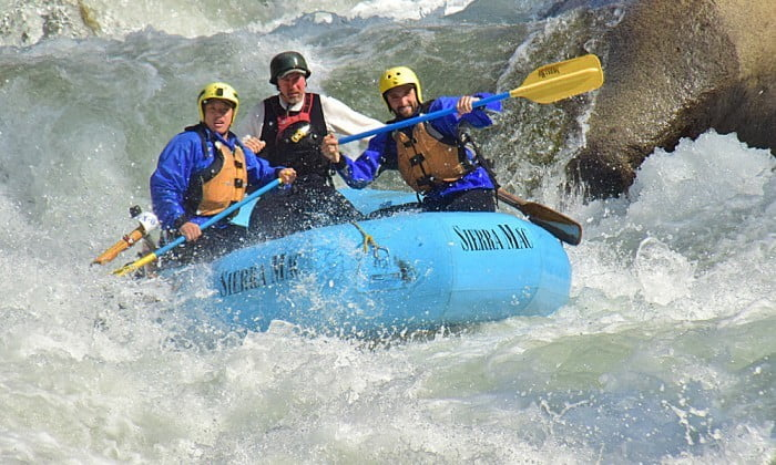 Rafters emerging from wave at Lewis' Leap on Cherry Creek
