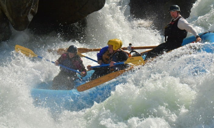 An oar-paddle combo raft hits the hole at Mushroom rapid on Cherry Creek/Upper Tuolumne